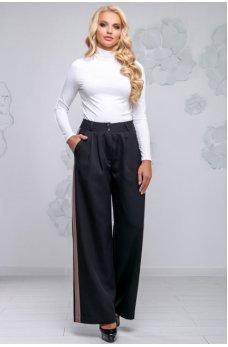 Черные свободные брюки с бежевыми вставками