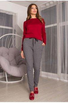 Серые принтованные брюки с карманами
