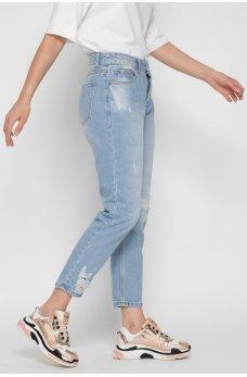 Голубые молодежные джинсы с потертостями