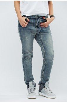 Серые стильные джинсы-скинни с потертостями