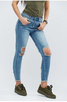Голубые стильные джинсы-скинни с рваным краем