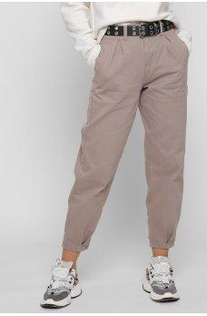 Бежевые практичные джинсовые брюки