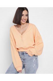 Модный персиковый свитшот с красивым вырезом