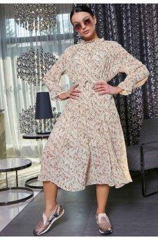 Бежевое платье в свободном фасоне с пышной юбкой плиссе