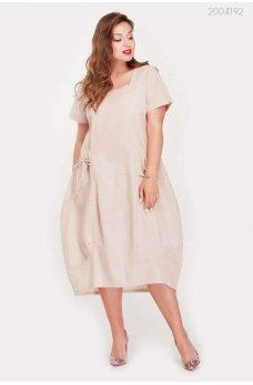 Бежевое модное платье миди с карманами