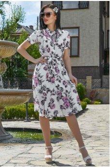 Элегантное платье белого цвета с цветочным принтом