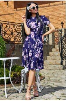 Элегантное платье синего цвета с цветочным принтом