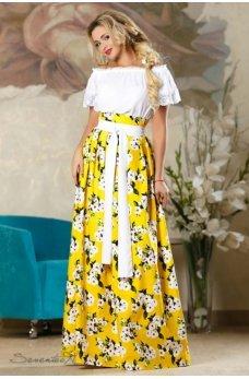 Желтая стильная длинная юбка с принтом