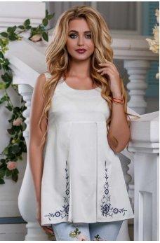 Белая коттоновая блузка А-силуэта
