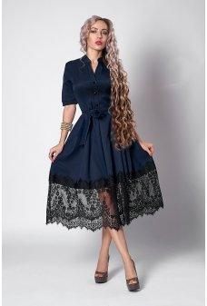 Красивое темно-синее платье с пышной юбкой