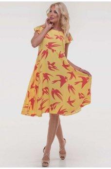 Желтое оригинальное платье с принтом