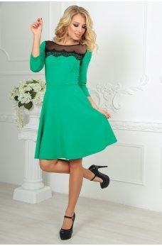 Зеленое кокетливое платье